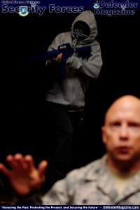 Tech. Sgt. Ajenna Smith, 422nd Security Forces Squadron noncommissioned officer in charge of training and simulated-active shooter, opens fire on a crowd during a commander's call at RAF Croughton, United Kingdom, July 22, 2014. Smith said her goal during this training exercise was to kill as many people as possible in a short amount of time. (U.S. Air Force photo by Staff Sgt. Jarad A. Denton/Released)
