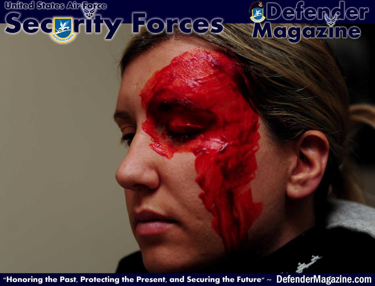 Tech. Sgt. Ajenna Smith, 422nd Security Forces Squadron noncommissioned officer in charge of training and simulated-active shooter, waits for the fake blood from her artificial head wound to properly set during an exercise at RAF Croughton, United Kingdom, July 22, 2014. As an active shooter, Smith said she would have exhibited signs of frustration, anger and isolation that friends and coworkers could have identified prior to the actual rampage. (U.S. Air Force photo by Staff Sgt. Jarad A. Denton/Released)