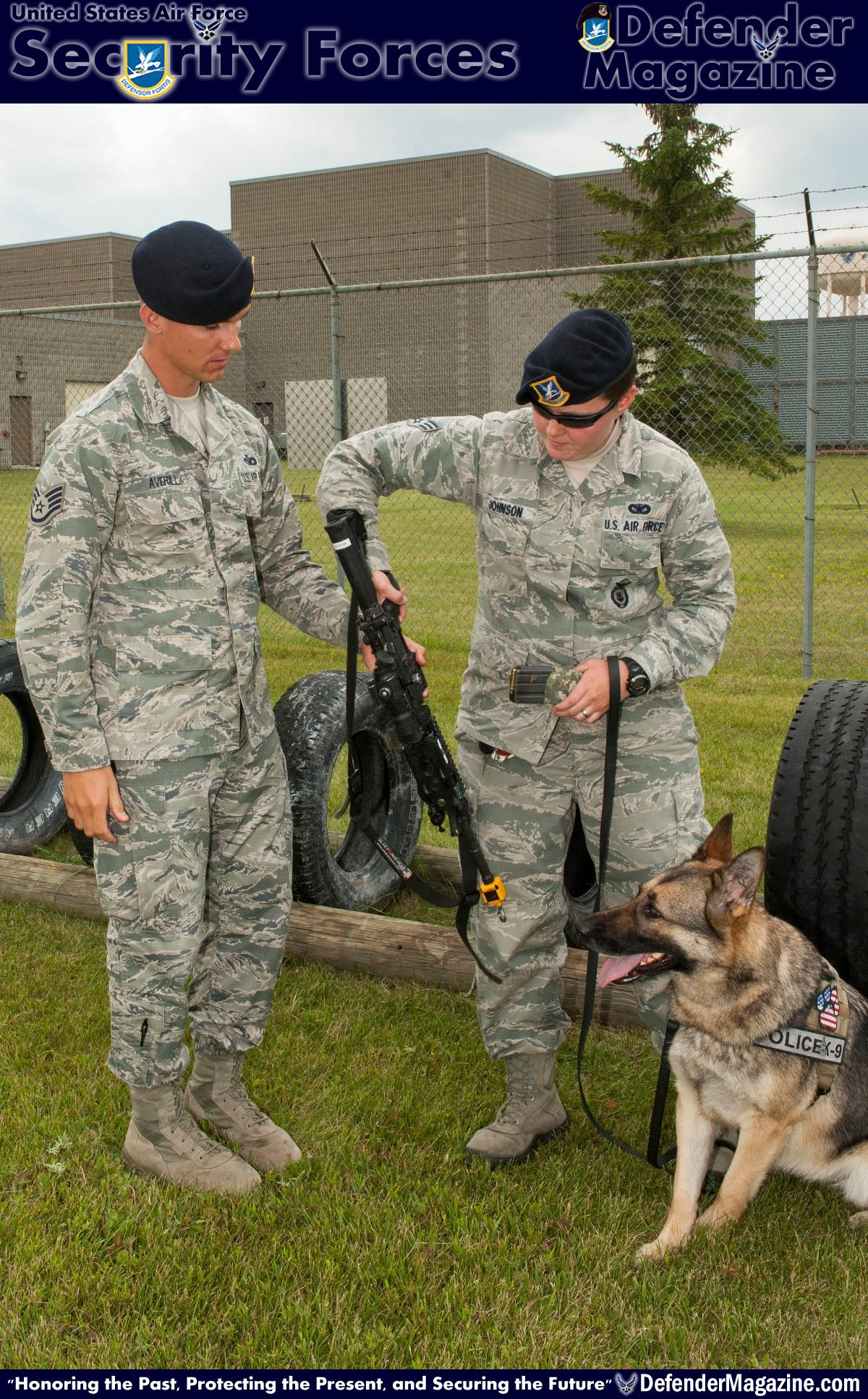 From pup to Alpha Staff Sgt. Christopher Averill, 5th Security Forces Squadron military working dog trainer, hands a practice weapon to Senior Airman Heather Johnson, 5th SFS MWD handler, during weapons training with her MWD Cyndy on Minot Air Force Base, N.D., July 29, 2014. Averill adheres to a master training plan that outlines the requirements for new handlers. He also works side by side with the handlers to demonstrate proper techniques and methods for working with their MWD. (U.S. Air Force photo/Senior Airman Stephanie Morris)