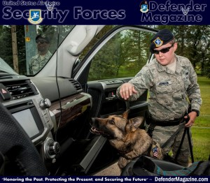 "Senior Airman Heather Johnson, 5th Security Forces Squadron military working dog handler, gives her MWD Cyndy the command ""seek"" during a vehicle inspection on Minot Air Force Base, N.D., July 29, 2014. In addition to their duties on the base, Johnson and Cyndy also provide security for events off base. The two perform demonstrations for the local community, security checks for downtown events and at venues for Air Force events such as the Air Force Ball. (U.S. Air Force photo/Senior Airman Stephanie Morris)"
