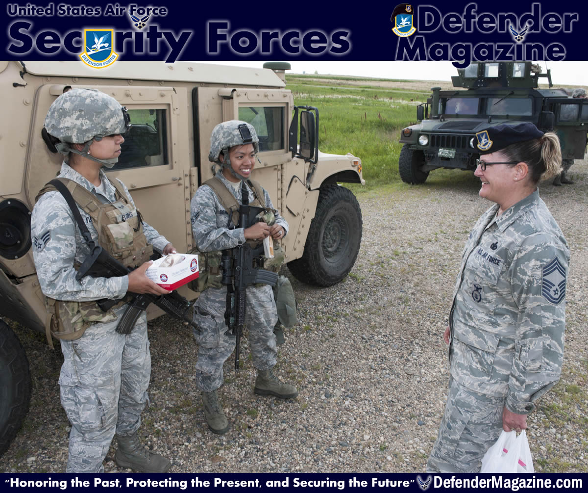 Chief Master Sgt. Melissa Permar, 791st Missile Security Forces Squadron security forces manager, speaks with Airmen from the 791st MSFS, during a morale visit to the missile complex in North Dakota, July 30, 2014. Permar stressed that post visits are an essential aspect of the job for several reasons: They allow leadership to build rapport with Airmen, increase their knowledge of each person's well-being, and get Airmen's input on issues they may be having.(U.S. Air Force photo/Senior Airman Stephanie Morris)