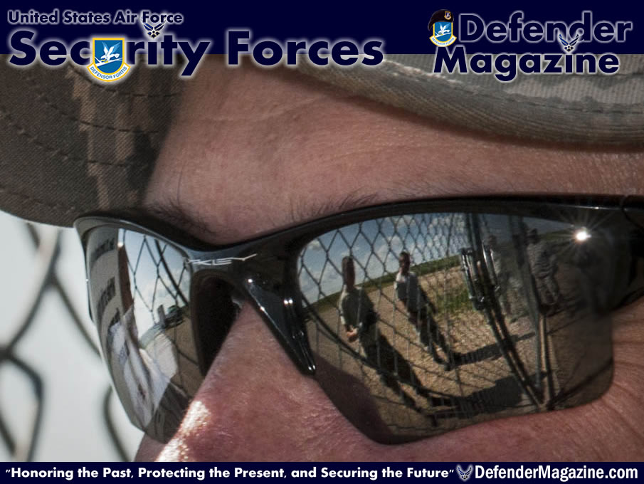 791st Missile Security Forces Squadron and 91st Missile Maintenance Squadron Airmen are reflected in the glasses of Master Sgt. Tad Wagner, 91st MMXS facility superintendent, during a morale visit to the missile complex in North Dakota, July 30, 2014. During Wagner's last trip to the field he covered approximately 260 miles. These visits are important because leadership in both career fields can ensure the well-being of their Airmen, Wagner said.(U.S. Air Force photo/Senior Airman Stephanie Morris)