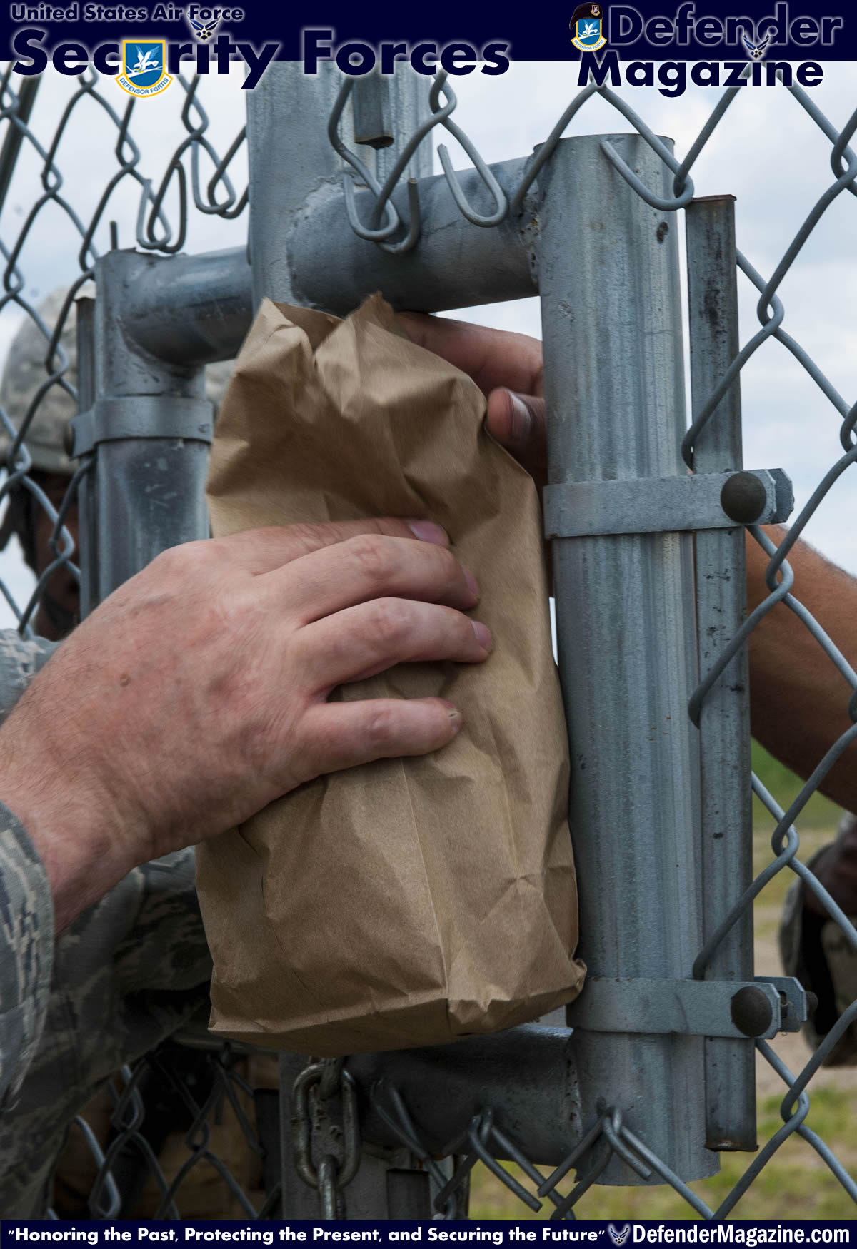 Food is passed through the gate at a launch facility during a morale visit to the missile complex in North Dakota, July 30, 2014. During their regular operations, 791st Airmen patrol the missile complex, and guard teams who are performing regular maintenance to the different sights and assets for upkeep. (U.S. Air Force photo/Senior Airman Stephanie Morris)
